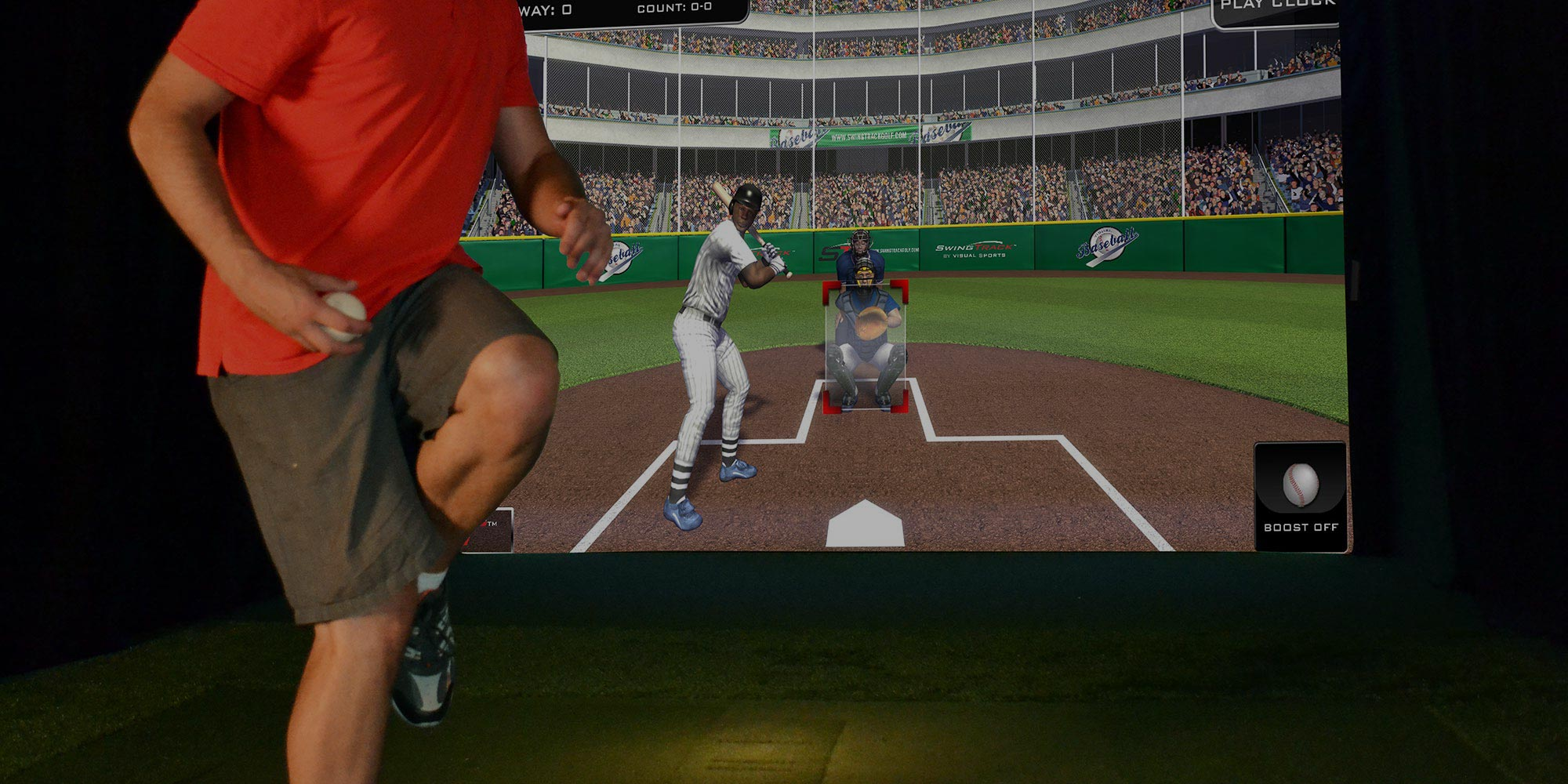 Man throwing pitch using baseball simulator..